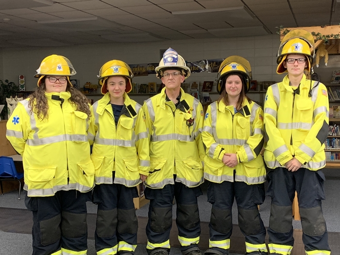 Cuba High School students Elizabeth Markley, Tegan Strode, Ariel Schnarr, Bradley Mercer, and Taylor Lester (not pictured) with their EMT captain Bobby Schnarr.